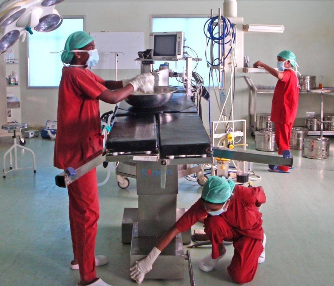 Nursing interns prepare the operating theatre under the guidance of qualified nurses in India.
